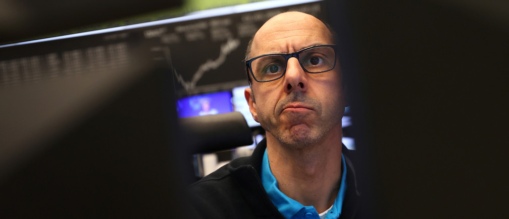 A stock trader looks at his screens during a trading session at Frankfurt's stock exchange in Frankfurt, Germany, March 13, 2020.