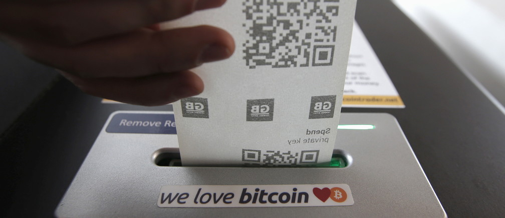A bitcoin ATM prints out a receipt for a user at the 'Vape Lab' cafe where it is possible to both use and purchase the bitcoin currency, in London March 24, 2015.