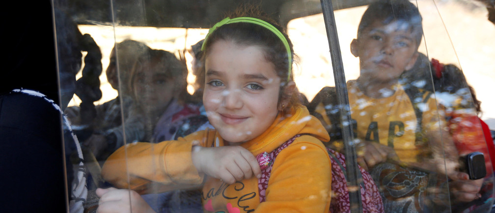 Syrian refugee children wait to leave in a bus after finishing school in Mount Lebanon, October 7, 2016. REUTERS/Mohamed Azakir - RTSR7GO