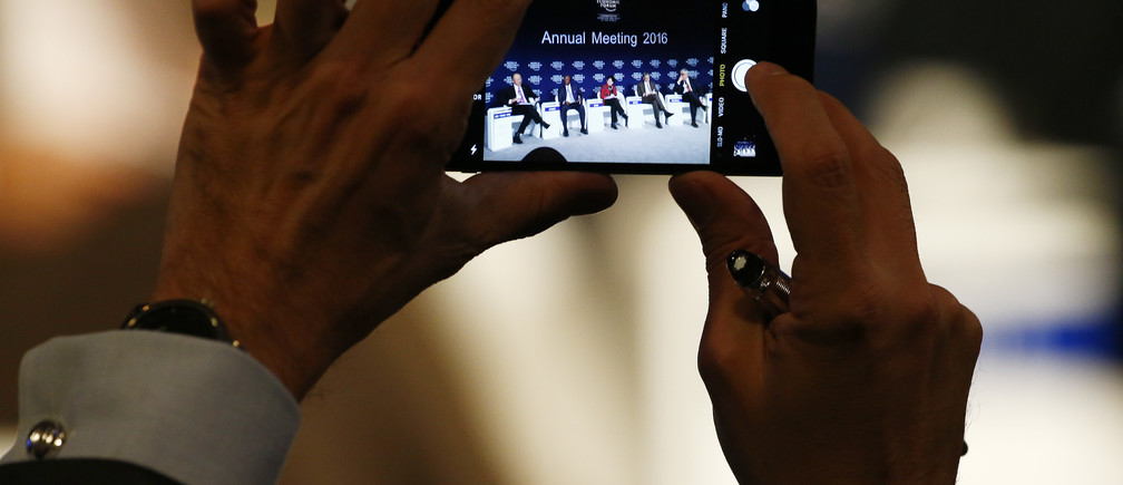 A participant takes a picture during the annual meeting of the World Economic Forum (WEF) in Davos, Switzerland January 22, 2016.