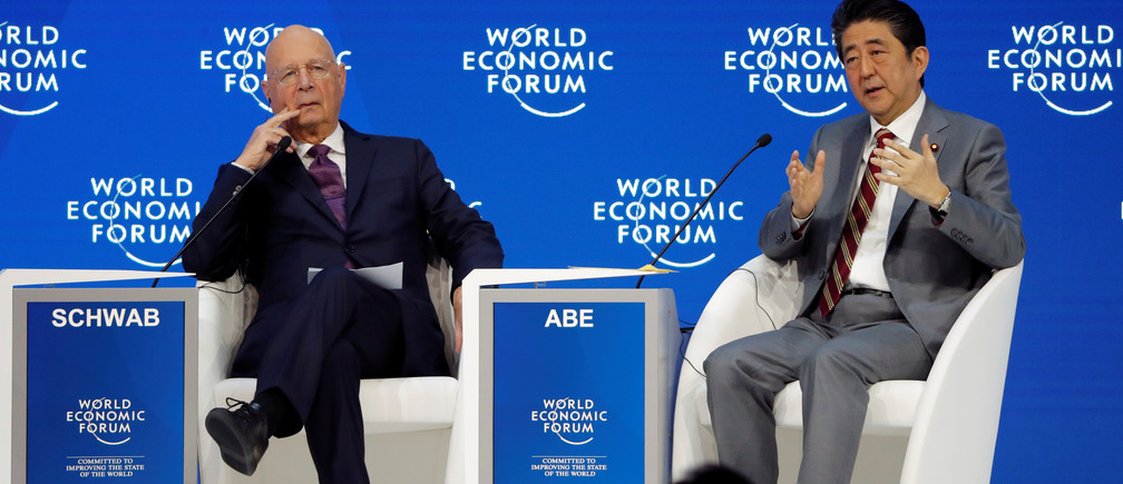Japanese Prime Minister Shinzo Abe and Executive Chairman of the WEF Klaus Schwab attend the World Economic Forum (WEF) annual meeting in Davos, Switzerland, January 23, 2019. REUTERS/Arnd Wiegmann - RC1C4176BCC0