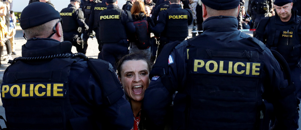 An activist shouts as she is carried away by police officers during the Extinction Rebellion protest in Prague, Czech Republic, October 12, 2019. REUTERS/David W Cerny