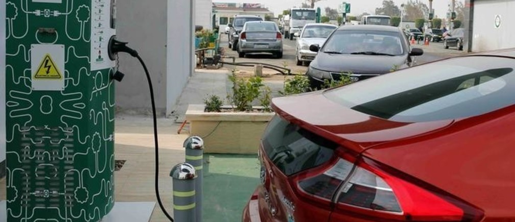 An electric car charging box is seen with Hyundai's Ioniq as an effort to reduce fuel consumption and gradually decrease the country's carbon footprint, at Revolta charging station in Cairo, Egypt, February 19, 2018. Picture taken February 19, 2018. REUTERS/Amr Abdallah Dalsh