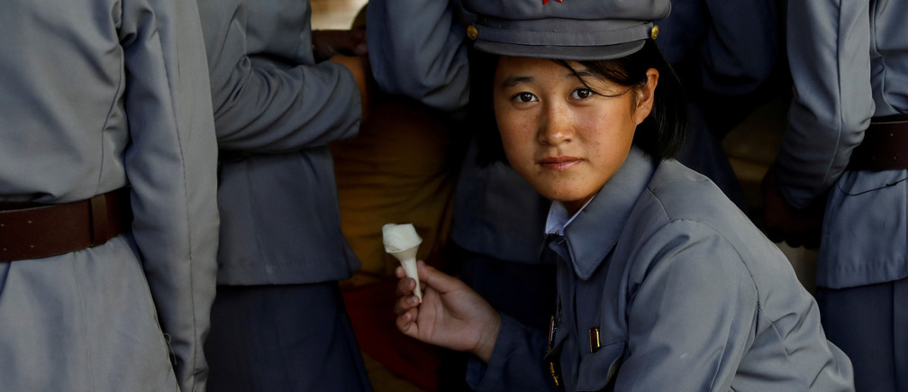 A soldier eats ice cream as she visits a zoo in Pyongyang, North Korea, September 12, 2018