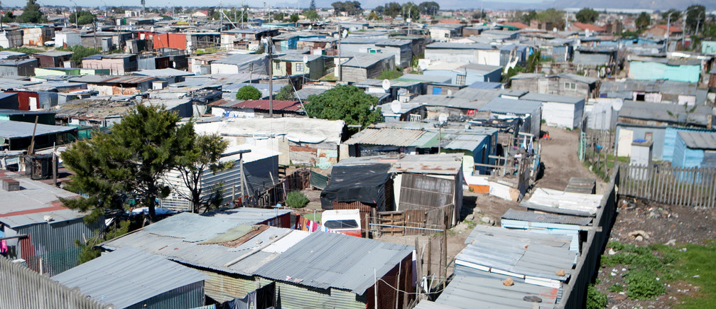 Shacks are seen at an informal settlement near Cape Town, South Africa, September 14, 2016.  A process of 'upgrading' enables each shack in an informal settlement to receive basic services of water, electricity  and sanitation. Picture taken September 14, 2016. Nicky Milne/Thomson Reuters Foundation via REUTERS - RTX2V04Z