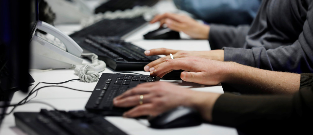 Employees, mostly veterans of military computing units, use keyboards as they work at a cyber hotline facility at Israel's Computer Emergency Response Centre (CERT) in Beersheba, southern Israel February 14, 2019. Picture taken February 14, 2019. REUTERS/Amir Cohen - RC1E423B2710