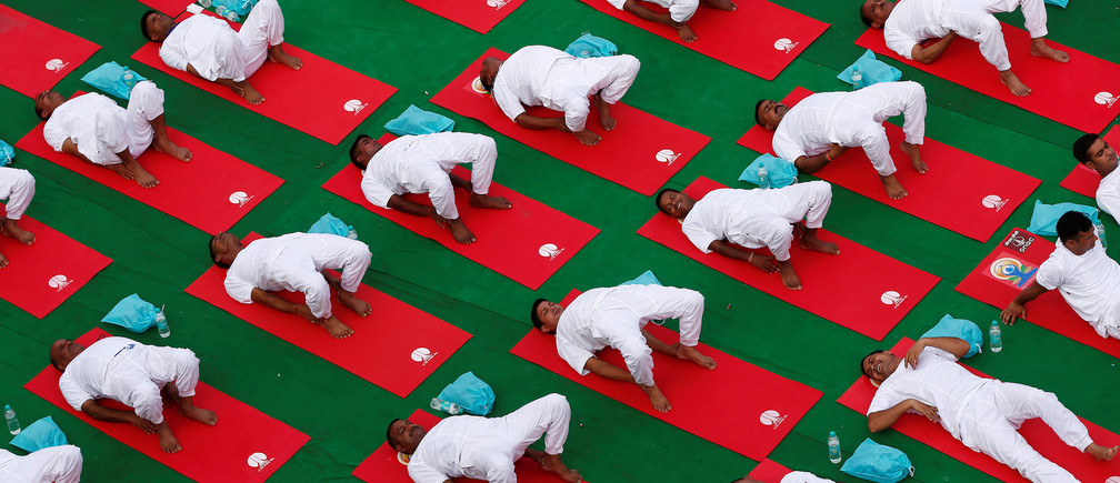 Participants perform yoga during World Yoga Day in New Delhi, India, June 21, 2016. REUTERS/Adnan Abidi - S1AETLCVMZAC