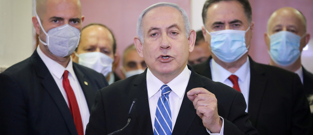 Israeli Prime Minister Benjamin Netanyahu delivers a statement before entering the district court room where he is facing a trial for alleged corruption crimes, in Jerusalem May 24 2020.