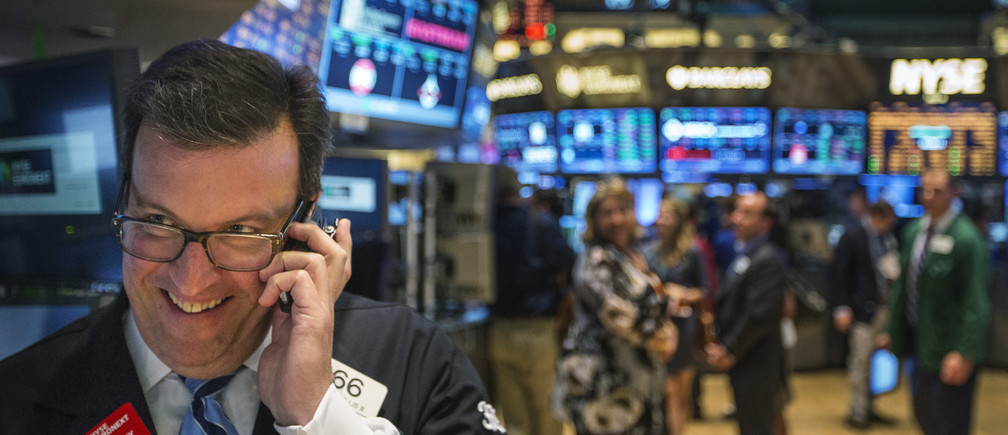 A trader works on the floor of the New York Stock Exchange shortly before the end of the day's trading in New York July 31, 2013. REUTERS/Lucas Jackson (UNITED STATES - Tags: BUSINESS TPX IMAGES OF THE DAY) - GM1E9810DM201