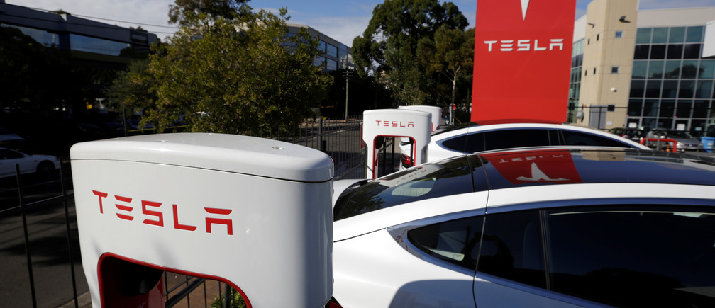 Tesla Model X cars are charged by superchargers at a Tesla electric car dealership in Sydney, Australia, May 31, 2017.  REUTERS/Jason Reed - RTX38AWK