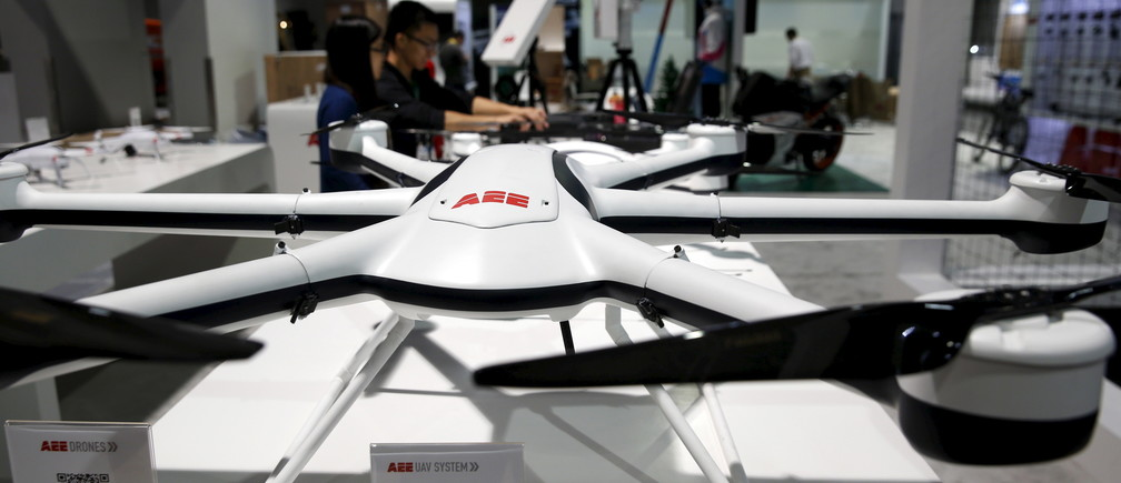 Workers set up a commercial drone display at the AEE Technology booth in the Las Vegas Convention Center during set-up for the 2016 CES trade show in Las Vegas, Nevada, January 5, 2016.