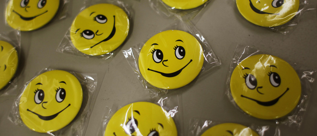 Badges for participants of a Laughter Yoga class are displayed before a exercise for the staff at Ocean Park in Hong Kong July 10, 2014. Consultancy firm ?Inspire 2 Aspire? run Laughter Yoga classes for corporations which partner Mahesh Pamnani believes ease stress and increases productivity and creativity among staff. Laughter Yoga was first developed 1995 in Mumbai, India by Dr. Madan Kataria, and has over 600 clubs in 60 countries, according to Laughter Yoga International.  REUTERS/Bobby Yip  (CHINA - Tags: SOCIETY HEALTH BUSINESS) - RTR3Y1WK