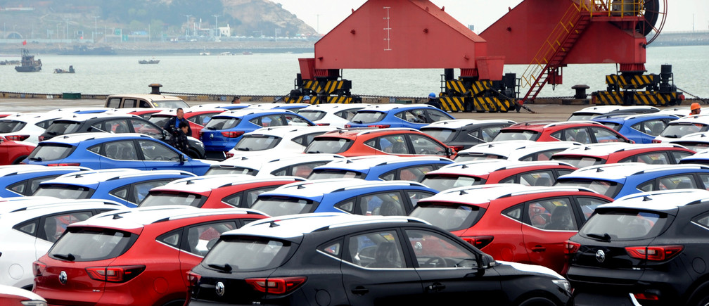 FILE PHOTO: Sports utility vehicles (SUVs) waiting to be exported are seen at a port in Lianyungang, Jiangsu province, China April 5, 2018.  REUTERS/Stringer/File Photo  ATTENTION EDITORS - THIS IMAGE WAS PROVIDED BY A THIRD PARTY. CHINA OUT. - RC1FC7341690