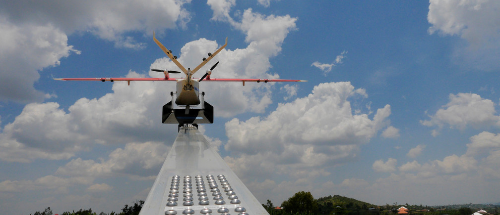 A drone is placed on a launch pad at operations center in Muhanda, south of Rwanda's capital Kigali where Zipline, a California-based robotics company delivered their first blood to patients using a drone October 12, 2016. Picture taken October 12, 2016. REUTERS/James Akena - RTX2PJU3