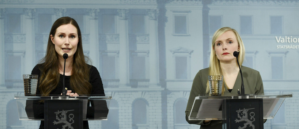 Finland's Prime Minister Sanna Marin and Minister of Interior Maria Ohisalo attend a news conference of the Finnish Government, regarding the coronavirus disease (COVID-19) spread, in Helsinki, Finland, May 4, 2020. Lehtikuva /Emmi Korhonen via REUTERS  ATTENTION EDITORS - THIS IMAGE WAS PROVIDED BY A THIRD PARTY. NO THIRD PARTY SALES. NOT FOR USE BY REUTERS THIRD PARTY DISTRIBUTORS. FINLAND OUT. NO COMMERCIAL OR EDITORIAL SALES IN FINLAND. - RC2THG9Y54FF