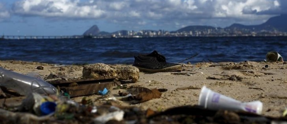 Rubbish is pictured at Bica beach, on the banks of the Guanabara Bay, with the Sugar Loaf mountain in background, 500 days ahead the Rio 2016 Olympic Games in Rio de Janeiro March 24, 2015. As part of its Olympic bid, Rio promised to clean up 80 percent of the bay for the games. But local government officials have already admitted that a cleanup by 2016 is not achievable. Despite millions of dollars of investment over the years, the bay still stinks of sewage. Sailors who visited the city for test events complained of a floating sofa and a dead dog in the water.       To match OLYMPICS-BRAZIL/RUBBISH      REUTERS/Ricardo Moraes
