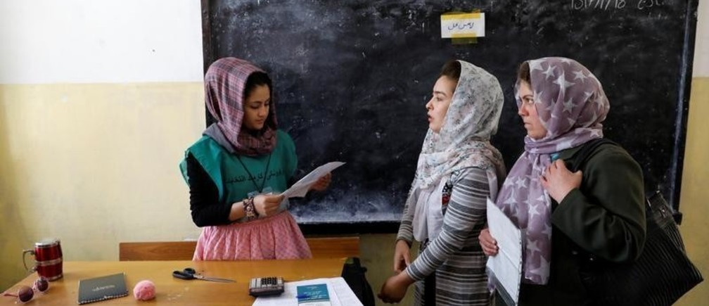 Afghan women arrive at a voter registration centre to register for the upcoming parliamentary and district council elections in Kabul, Afghanistan April 23, 2018.