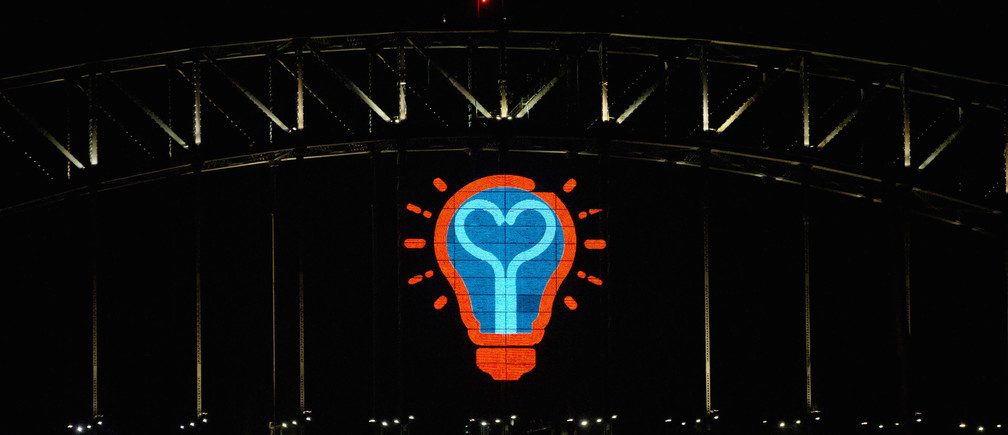 A light bulb motif made from LED lights is pictured on the side of the  Sydney Harbour Bridge following the annual fireworks display to usher in the new year, early January 1, 2015. More than 10,000 aerial fireworks, 25,000 shooting comets and 100,000 pyrotechnic effects were used during the annual Sydney Harbour New Year's Eve show, with an estimated 1.6 million people watching from along the harbour foreshore, local media reported.  REUTERS/Jason Reed    (AUSTRALIA - Tags: SOCIETY ANNIVERSARY) - GM1EACV1OA201