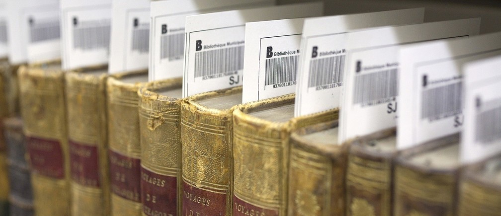 Barcode labels are seen inside rare books ahead of digitisation at the Municipal Library of Lyon in this January 15, 2010 file picture.