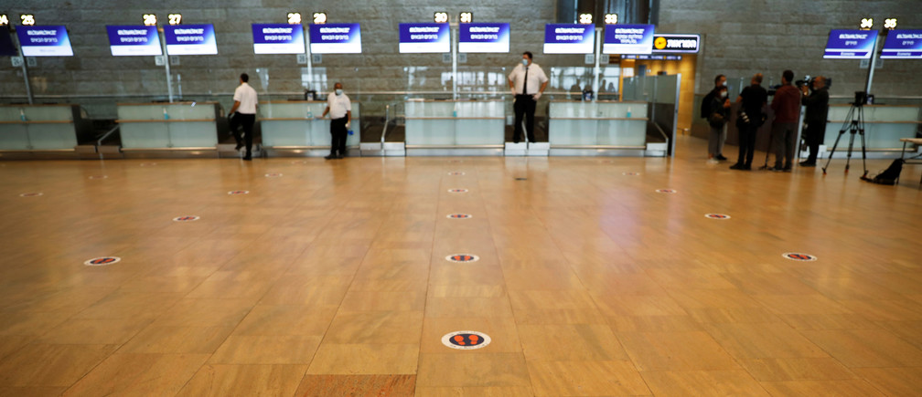 A social distancing marker is seen on the floor at the departures terminal as Israel's airport authority announced a pilot programme revealing what passengers leaving Israel should except as air travel gradually returns to normal after weeks of bare minimum flights due to the coronavirus disease (COVID-19) outbreak, at Ben Gurion International Airport, in Lod, near Tel Aviv, Israel May 14, 2020. REUTERS/Ronen Zvulun - RC27OG9PMG53