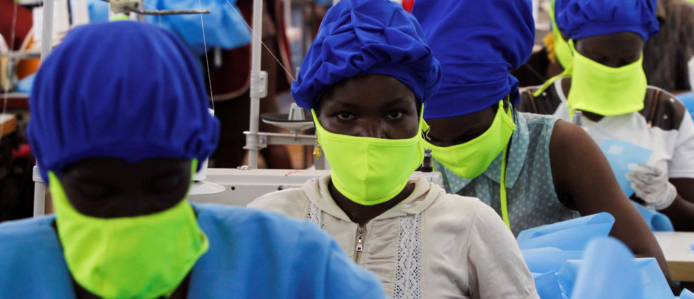 Workers are seen at a production line within the Shona Textiles Export Processing Zone (EPZ) as they make protective face masks and Personal Protective Equipment (PPE), as a measure to stem the coronavirus disease (COVID-19) outbreak, in Athi River near Nairobi, Kenya April 14, 2020. REUTERS/Njeri Mwangi     TPX IMAGES OF THE DAY - RC2E4G93D3EW