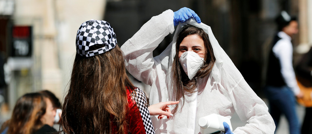 A teenager wears a costume as a reference to the coronavirus during the Jewish holiday of Purim, a celebration of the Jews' salvation from genocide in ancient Persia, as recounted in the Book of Esther. in Jerusalem March 8, 2020. REUTERS/Ronen Zvulun Coronavirus china virus health healthcare who world health organization disease deaths pandemic epidemic worries concerns Health virus contagious contagion viruses diseases disease lab laboratory doctor health dr nurse medical medicine drugs vaccines vaccinations inoculations technology testing test medicinal biotechnology biotech biology chemistry physics microscope research influenza flu cold common cold bug risk symptomes respiratory china iran italy europe asia america south america north washing hands wash hands coughs sneezes spread spreading precaution precautions health warning covid 19 cov SARS 2019ncov wuhan sarscow wuhanpneumonia  pneumonia outbreak patients unhealthy fatality mortality elderly old elder age serious death deathly deadly