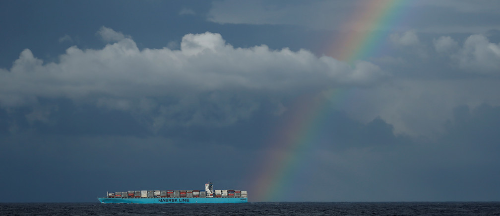 A rainbow is seen over the container ship 'Maersk Genoa' as it sails off the northern coast of Tunisia in the central Mediterranean December 1, 2018.  REUTERS/Darrin Zammit Lupi - RC1B72830B50