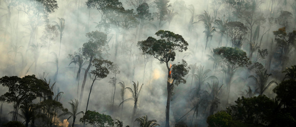 Smoke billows during a fire in an area of the Amazon rainforest near Porto Velho, Rondonia State, Brazil, September 10, 2019. REUTERS/Bruno Kelly - RC1562CB8500