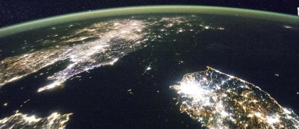 North Korea (the dark area) and South Korea at night are seen in an undated NASA handout picture from the International Space Station. The clarity of the night image is possible thanks to the European Space Agency's NightPod, installed on the station in 2012, according to a NASA news release. It incorporates a motorized tripod that compensates for the station's speed of approximately 17,500 mph and the motion of the Earth below.  REUTERS/NASA/Handout via Reuters  (OUTER SPACE - Tags: SCIENCE TECHNOLOGY)  ATTENTION EDITORS - THIS PICTURE WAS PROVIDED BY A THIRD PARTY. REUTERS IS UNABLE TO INDEPENDENTLY VERIFY THE AUTHENTICITY, CONTENT, LOCATION OR DATE OF THIS IMAGE. THIS PICTURE IS DISTRIBUTED EXACTLY AS RECEIVED BY REUTERS, AS A SERVICE TO CLIENTS. FOR EDITORIAL USE ONLY. NOT FOR SALE FOR MARKETING OR ADVERTISING CAMPAIGNS - TM3EA8E10TO01