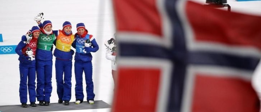 Cross-Country Skiing - Pyeongchang 2018 Winter Olympics - Women's 4x5km Relay - Alpensia Cross-Country Skiing Centre - Pyeongchang, South Korea - February 17, 2018. Gold medalists Ingvild Flugstad Oestberg, Astrid Uhrenholdt Jacobsen, Ragnhild Haga and Marit Bjoergen of Norway celebrate during the victory ceremony. REUTERS/Carlos Barria