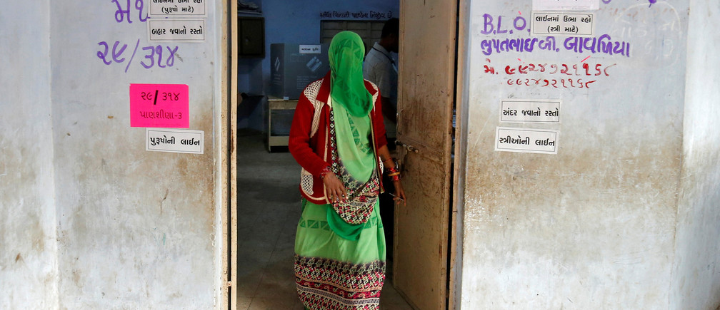 A woman leaves a polling booth after casting her vote during the first phase of Gujarat state assembly election in Panshina village of Surendranagar district December 9, 2017. REUTERS/Amit Dave - RC1753A326D0