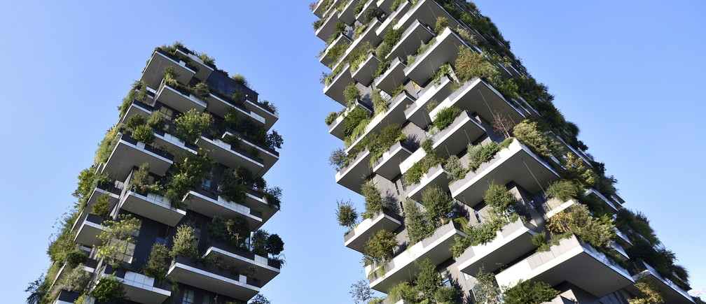 The Bosco Verticale (vertical forest) towers are seen in Milan, August 29, 2015. Long the ugly sister to Florence, Venice and Rome, Italy's business capital Milan is enjoying a renaissance, its once drab skyline coming to life and a new creative vibrancy emerging. Picture taken August 29, 2015. To match Feature ITALY-MILAN/      REUTERS/Flavio Lo Scalzo - GF10000197657