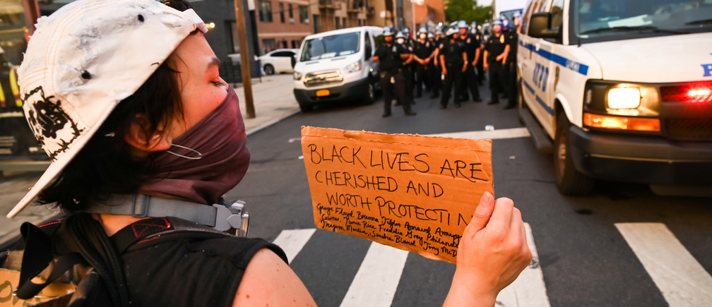 Demonstrators protest against the racial inequality in the aftermath of the death in Minneapolis police custody of George Floyd, in New York City, New York, U.S. June 11, 2020. Picture taken June 11, 2020. REUTERS/Idris Solomon - RC2I7H96PQ14