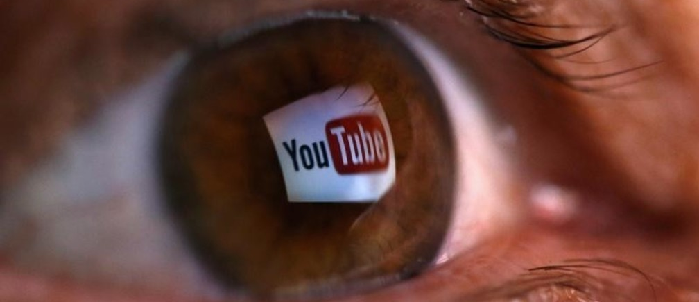 "A picture illustration shows a YouTube logo reflected in a person's eye, in central Bosnian town of Zenica, early June 18, 2014. Google Inc's YouTube said on June 17, 2014 that it plans to launch a paid streaming music service, amid criticism that its existing, free video website might block the music videos of labels that do not agree to its terms. YouTube has partnered with ""hundreds of major and independent"" music labels for the new service, the company said in a statement, confirming long-running rumors that the world's most popular online video website will offer a paid music service. The picture was flipped horizontally. REUTERS/Dado Ruvic (BOSNIA AND HERZEGOVINA - Tags: BUSINESS SCIENCE TECHNOLOGY TELECOMS MEDIA TPX IMAGES OF THE DAY) - GM1EA6I0OFQ01"