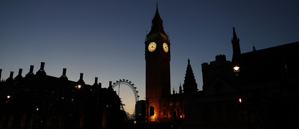 Dawn breaks behind the Houses of Parliament in Westminster, London, Britain