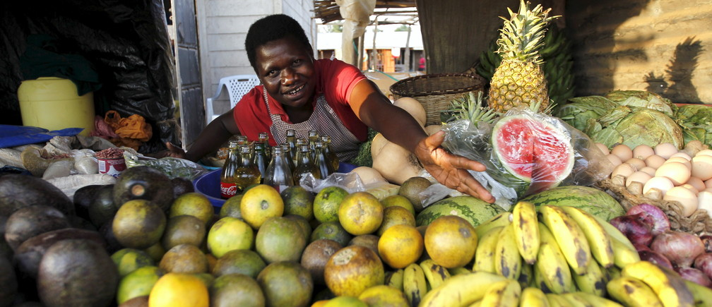 Imelda Akinyi, 25, arranges fruit at her stall in Kogelo, west of Nairobi, Kenya