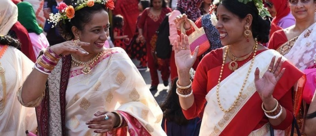 Moushumi Sutradhar, a Bangladeshi American, dances with her friend during celebrations for the Bengali New Year, which is also referred to as Pahela Baishakh, in Jackson Heights, Queens, New York, U.S. April 14, 2018.