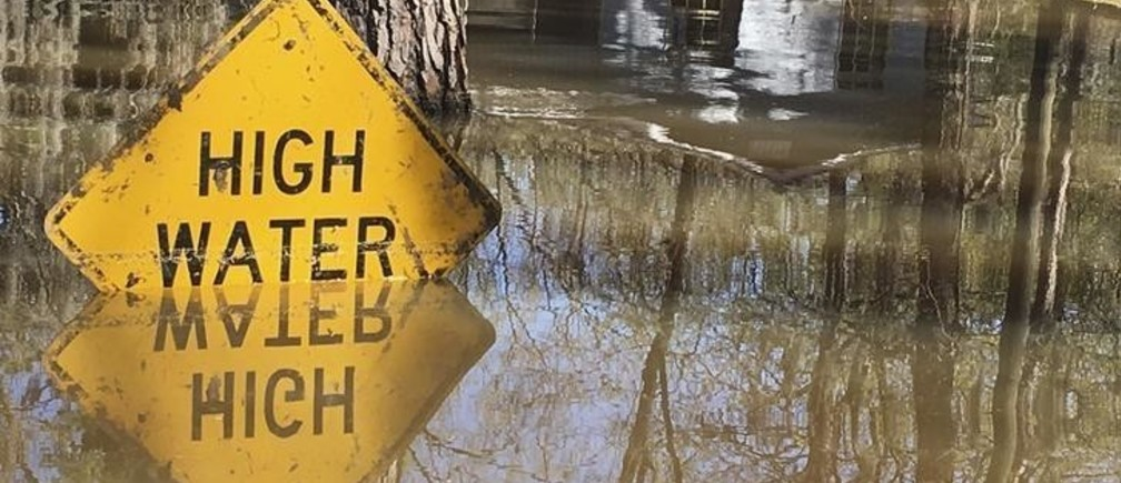 A high water sign is submerged near Lake Bistineau in Webster Parish, Louisiana March 14, 2016. The death toll from storms in Southern U.S. states rose to five as storm-weary residents of Louisiana and Mississippi watched for more flooding on Monday from drenching rains that inundated homes, washed out roads and prompted thousands of rescues.