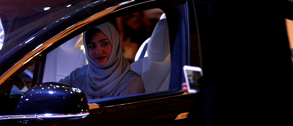 A Saudi woman is photographed as she checks a car at a showroom in Riyadh, Saudi Arabia October 5, 2017. REUTERS/Faisal Al Nasser     TPX IMAGES OF THE DAY - RC1801BA7260