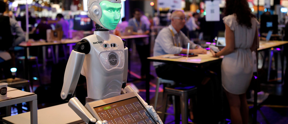 A 'SociBot' humanoid robot, manufactured by Engineered Arts, is displayed at the Viva Technology conference in Paris, France, June 15, 2017. REUTERS/Benoit Tessier - RC18FAAA94E0
