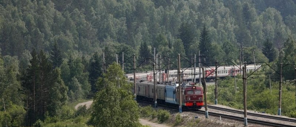 A train moves along the Trans-Siberian Railway through the Taiga district, some 90 km (56 miles) southwest of Russia's Siberian city of Krasnoyarsk, July 2, 2012. Picture taken July 2, 2012. To match Special Report  RUSSIA-RAILWAYS/        REUTERS/Ilya Naymushin (RUSSIA - Tags: TRANSPORT POLITICS BUSINESS) - GM1E87P0ZP101