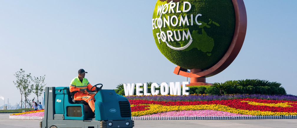 A cleaner drives a sweeper-scrubber past a flower installation for the upcoming Summer Davos meeting by the World Economic Forum (WEF) in Dalian, Liaoning province, China June 11, 2019. Picture taken June 11, 2019. REUTERS/Stringer ATTENTION EDITORS - THIS IMAGE WAS PROVIDED BY A THIRD PARTY. CHINA OUT. - RC1F0926B340