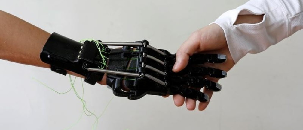 """Angel Peng, 8, who injured her hand in a scalding accident when she was nine months old, shakes hands with her mother wearing a 3D-printed prosthetic hand designed and built by engineer Chang Hsien-Liang, in Taoyuan, Taiwan, May 8, 2017. REUTERS/Tyrone Siu          SEARCH """"PROSTHETIC 3D"""" FOR THIS STORY. SEARCH """"WIDER IMAGE"""" FOR ALL STORIES. - RC133453A190"""