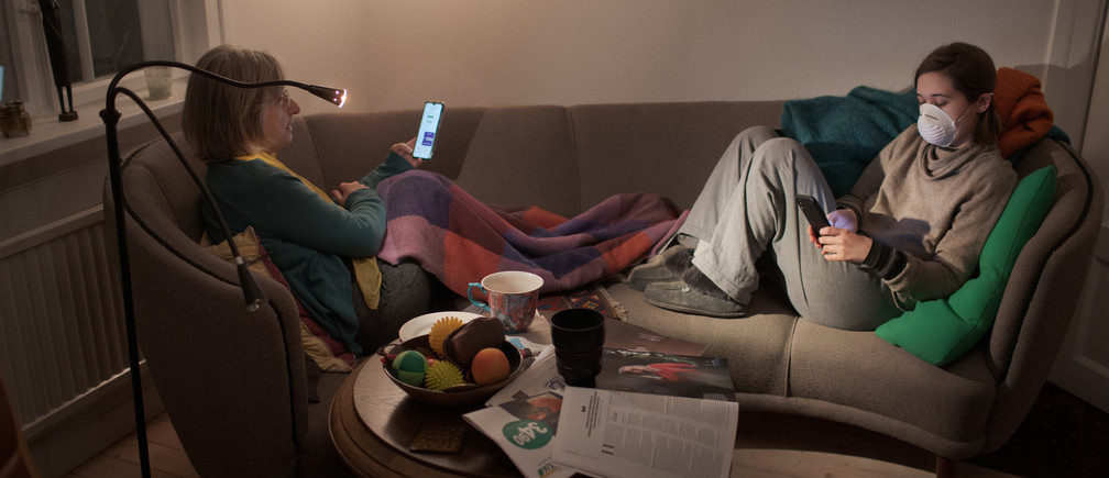 "Reuters photographer Nora Savosnick and her mother, Chava Savosnick, look at their phones while sitting in their living room, as Nora completes 14-days of quarantine since arriving from New York, during the coronavirus disease (COVID-19) outbreak, in Oslo, Norway, March 30, 2020. ""The best part is that I'm getting a lot closer to you guys, and I don't think I would ever get this close if it hadn't been for me literally being locked down in this house. ... And I think a lot of people will come out of this knowing the people they lived in the house with better. And I'm very grateful for that"" said Nora. REUTERS/Nora Savosnick SEARCH ""SAVOSNICK QUARANTINE"" FOR THIS STORY. SEARCH ""WIDER IMAGE"" FOR ALL STORIES.  THE IMAGES SHOULD ONLY BE USED TOGETHER WITH THE STORY - NO STAND-ALONE USES. TPX IMAGES OF THE DAY. - RC2DWF9J03P6"