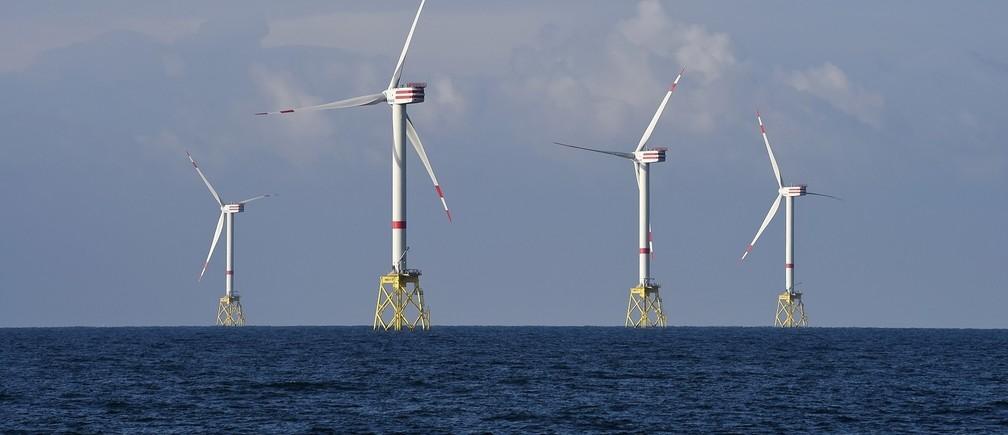 """A view shows windmills of several wind farms at the so-called """"HelWin-Cluster"""", located 35 kilometres (22 miles) north of the German island of Heligoland November 5, 2014. As European governments start to curb offshore renewable power subsidies, utilities, wind turbine makers and installers are racing to cut costs to help the industry survive. Britain, Germany and the Netherlands, wary of committing billions of euros when budgets are tight, have announced subsidy cuts in the past 18 months - a blow to the European offshore wind industry which employs nearly 60,000 people. This has led the European Wind Energy Association (EWEA) to slash its forecasts for installed offshore capacity in Europe. However, utilities remain keen to invest in offshore wind - which the EWEA says is the fastest-growing power technology in Europe."""