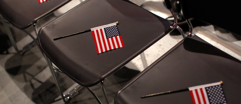 U.S. flags are placed on seats before a special citizenship ceremony for children at the Museum of Food and Drink in Brooklyn, New York City, U.S. December 23, 2016.