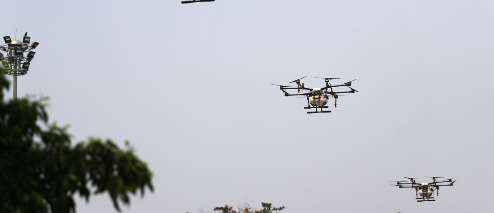 Drones fly and spray water during an operation to reduce air pollution near the Giant Swing and Wat Suthat in Bangkok, Thailand, January 31, 2019. REUTERS/Athit Perawongmetha - RC1221E23520