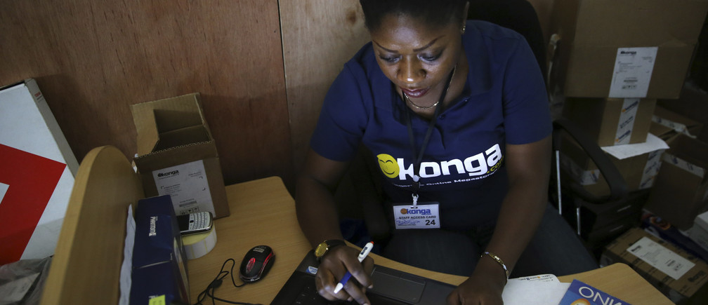 A staff member inputs data at the warehouse of Konga online shopping company in Lagos, Nigeria.
