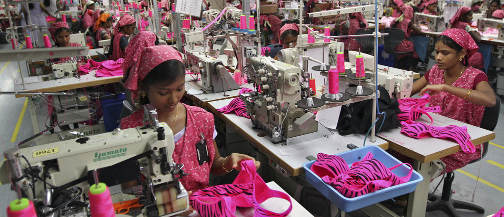 Workers produce bras for export at the Intimate Fashions factory in Kanchipuram district, 30 km (18 miles) south of the India's southern city of Chennai, May 22, 2012. For conservative India's rural women, a project giving them jobs in the manufacturing sector is not just an end to poverty, but brings empowerment and respect in this deeply patriarchal society. Intimate Fashions - which produces bras for Victoria's Secret and the La Senza brand - is one of thousands of firms that have set up in Tamil Nadu's Kanchipuram district in recent years. To match INDIA-WOMEN/EMPOWERMENT  REUTERS/Babu (INDIA - Tags: BUSINESS EMPLOYMENT TEXTILE) - GM1E85M1O3Z01