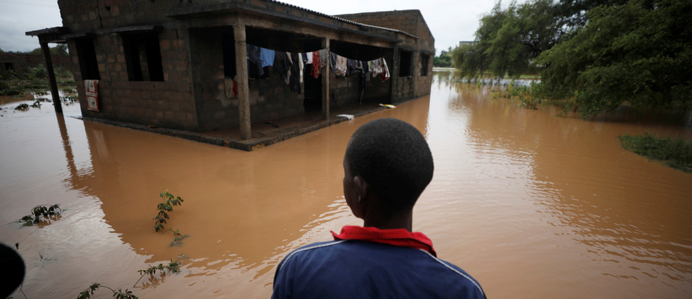Agiro Cavanda looks at his flooded home in the aftermath of Cyclone Kenneth, at Wimbe village in Pemba, Mozambique, April 29, 2019. REUTERS/Mike Hutchings